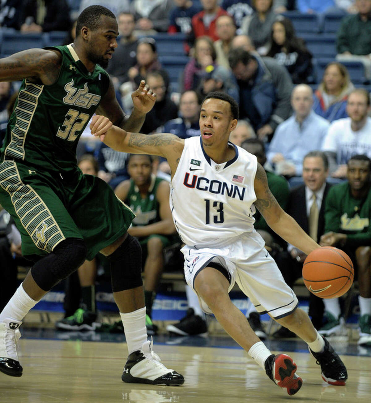 Connecticut's Shabazz Napier, right, drives past South Florida's Toarlyn Fitzpatrick during the first half of an NCAA college basketball game in Storrs, Conn., Sunday, Feb. 3, 2013. (AP Photo/Fred Beckham)