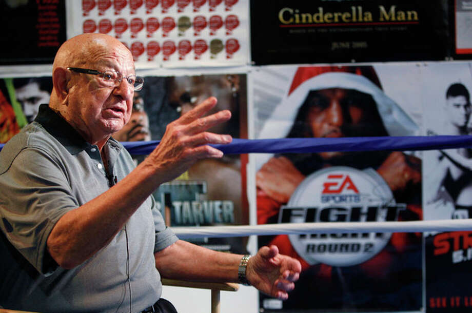 FILE - In this Sept. 23, 2012, file photo, Angelo Dundee gestures during an interview at the opening of the new 5th Street Gym in Miami Beach, Fla. Dundee, the trainer who helped groom Muhammad Ali and Sugar Ray Leonard into world champions and became one of boxing's most recognizable figures, died Wednesday, Feb. 1, 2012. He was 90. (AP Photo/Wilfredo Lee, File) / AP2010