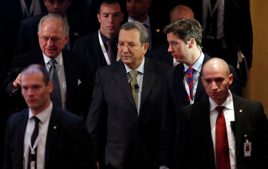 Israeli Defense Minister Ehud Barak, center, arrives for a meeting of the Security Conference in Munich, southern Germany, on Sunday, Feb. 3, 2013. The 49th Munich Security Conference started Friday until Sunday with experts from 90 delegations. (AP Photo/Matthias Schrader) / AP