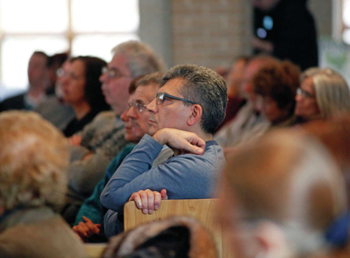 A large group of attendees listen to a panel of speakers during community forum on gun violence held by The Social Action Committee at Temple Israel of Westport Sunday afternoon. Hour Photo / Danielle Robinson