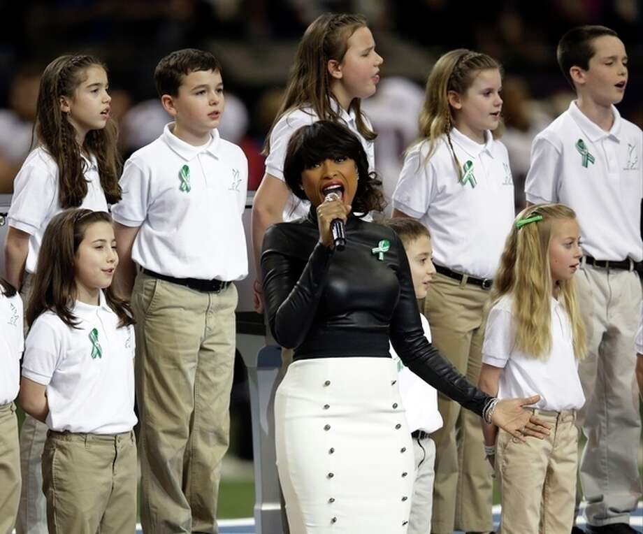 "Jennifer Hudson, center, sings ""God Bless America"" before the NFL Super Bowl XLVII football game between the San Francisco 49ers and the Baltimore Ravens, Sunday, Feb. 3, 2013, in New Orleans. (AP Photo/Evan Vucci) / AP"