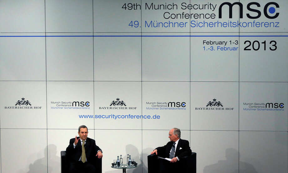 Ehud Barak, Defence Minister of Israel, left, gestures next to Wolfgang Ischinger, Chairman of the Security Conference, during a meeting at the Conference in Munich, southern Germany, on Sunday, Feb. 3, 2013. The 49th Munich Security Conference started Friday until Sunday afternoon with experts from 90 delegations. (AP Photo/Matthias Schrader) / AP
