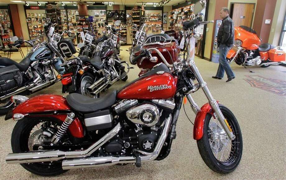 In this Jan. 20, 2012 photo, Harley-Davidson motorcycles are on display in the show room of Hall's Harley-Davidson Cycles, in Springfield, Ill. Iconic motorcycle maker Harley-Davidson says it posted a $105.7 million fourth-quarter profit, reversing a year-ago loss, on higher sales and easy comparisons to a quarter hurt by one-time charges. (AP Photo/Seth Perlman) / AP