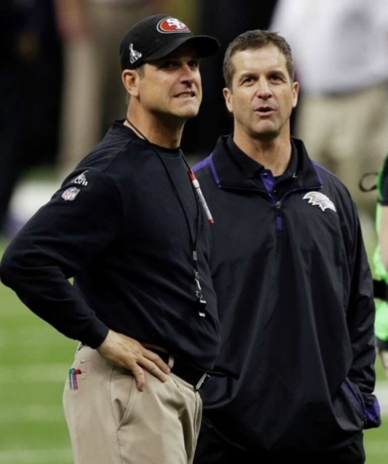 San Francisco 49ers head coach Jim Harbaugh, left, stands with his brother Baltimore Ravens head coach John Harbaugh before the NFL Super Bowl XLVII football game, Sunday, Feb. 3, 2013, in New Orleans. (AP Photo/Gene Puskar) / AP