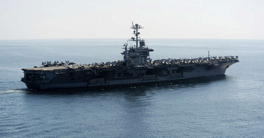In this Nov. 12, 2011photo provided by the U.S. Navy, the Nimitz-class aircraft carrier USS John C. Stennis (CVN 74) transits the Straits of Hormuz. The Pentagon on Tuesday, Jan. 3, 2012 answered an Iranian warning to keep U.S. aircraft carriers out of the Persian Gulf by declaring that American warships will continue regularly scheduled deployments to the strategic waterway. The Navy has said the Stennis and another vessel exited the Gulf through the Strait of Hormuz a week ago, after operating in the area. (AP Photo/U.S. Navy, Petty Officer 3rd Class Kenneth Abbate) / US Navy