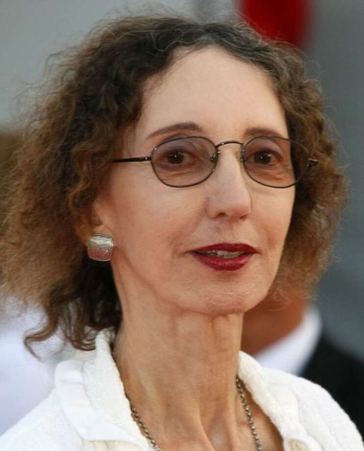 """FILE - In this Sept. 9, 2010 file photo, U.S. writer Joyce Carol Oates arrives for the screening of the film """" Fair Game """" at the 36th American Film Festival in Deauville, Normandy, France. (AP Photo/Michel Spingler, file)"""