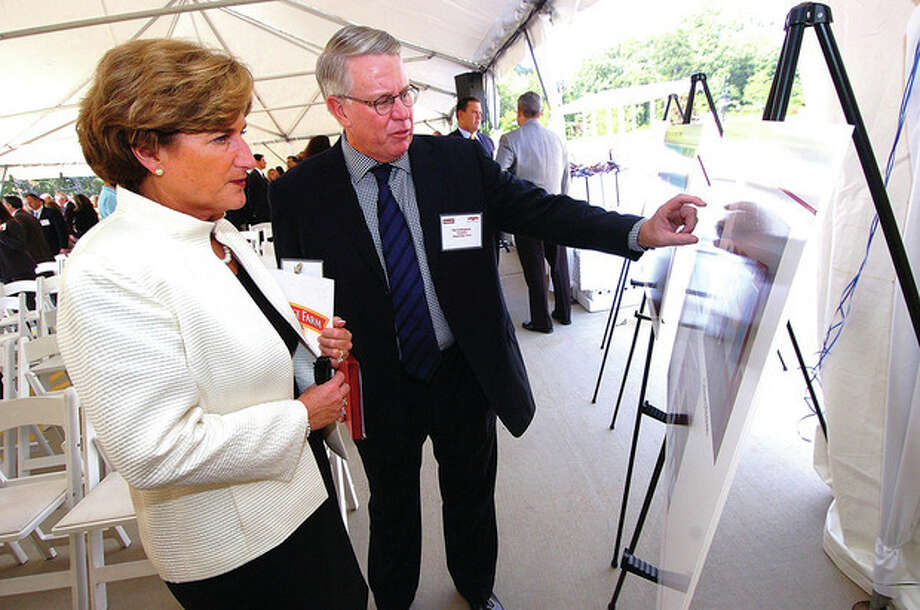 Hour Photo by Alex von Kleydorff Pat Callaghan, president of Pepperidge Farm, shows Denise Morrison, president and CEO of Campbell Soup Company, the plans for the new Innovation Center in Norwalk during a groundbreaking ceremony held Monday. / 2011 The Hour Newspapers