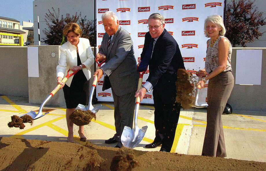 Hour photo by Alex von Kleydorff Denise Morrison, president and CEO, Campbell Soup Company, Mayor Richard Moccia, Pat Callaghan president, Pepperidge Farm and Catherine Smith, director, Connecticut Department of Economice and Community Development , break ground on the new Innovation Center at Pepperidge Farm in Norwalk on Monday. / 2011 The Hour Newspapers