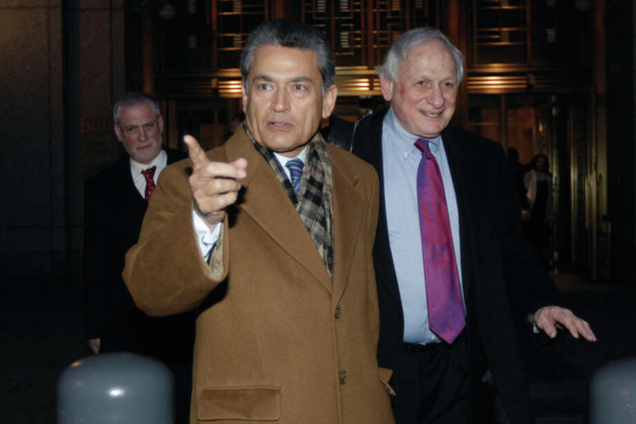 Former Goldman Sachs board member Rajat Gupta, left, exits Manhattan federal court with his attorney Gary Naftalis, Thursday, Jan. 5, 2012 in New York. Gupta of Westport, Conn., was charged last year with conspiracy and securities fraud. Free on $10 million bail, he faces trial April 9. (AP Photo/Mary Altaffer) / AP