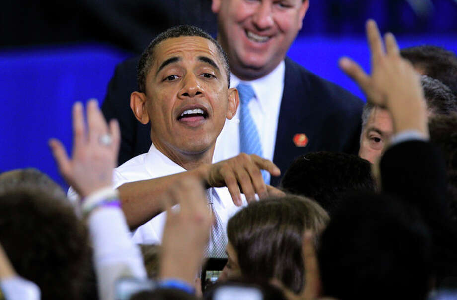 President Barack Obama greets supporters after his speech at the University of Michigan in Ann Arbor, Mich., Friday, Jan. 27, 2012. (AP Photo/Carlos Osorio) / AP