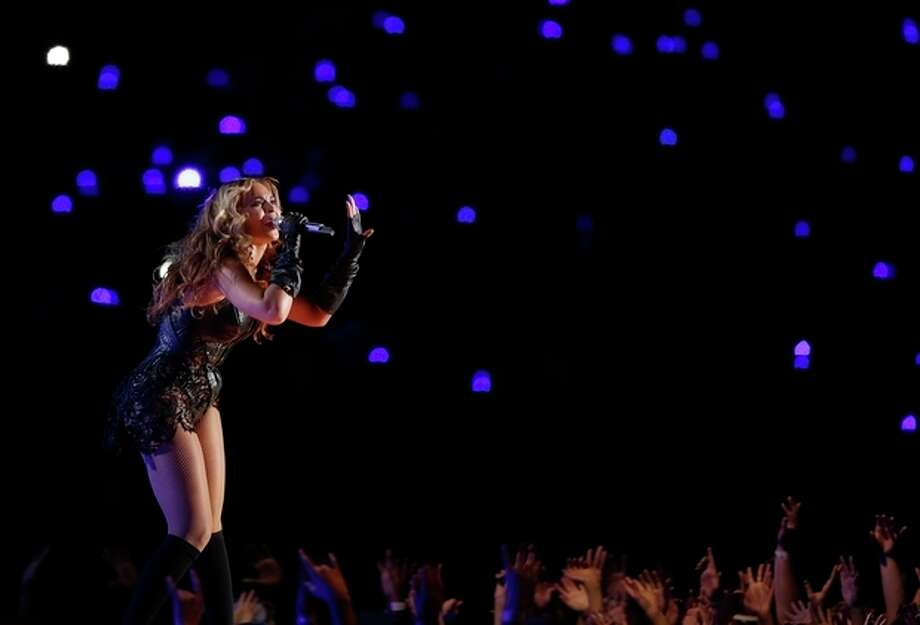 Beyonce performs during the halftime show of the NFL Super Bowl XLVII football game between the San Francisco 49ers and the Baltimore Ravens, Sunday, Feb. 3, 2013, in New Orleans. (AP Photo/Bill Haber) / FR170136 AP