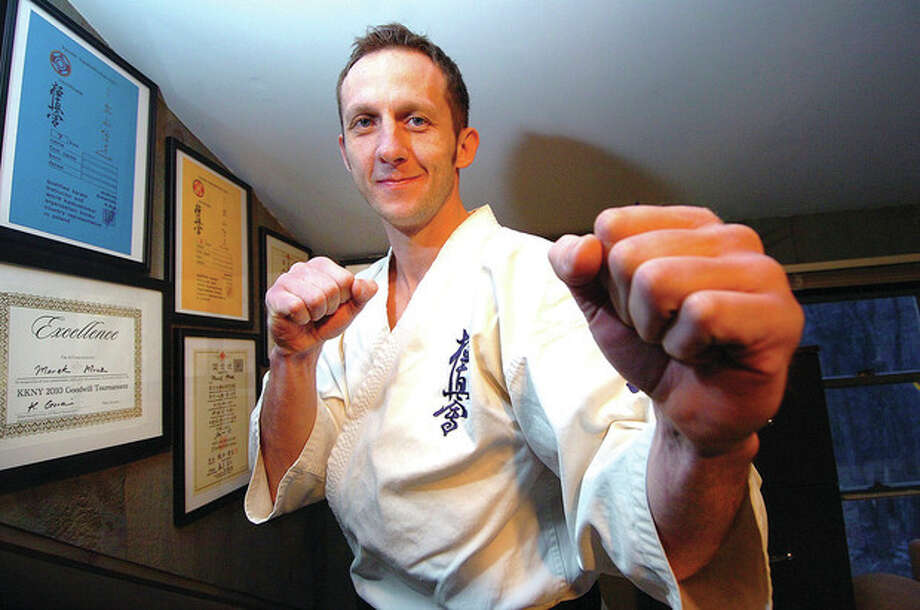 Marek Mroz of Wilton, who placed third at the U.S. Weight Category Karate Championships. Mroz will represent North America in the Kyokushinkaikan Karate Championships in Japan later this month. The 36-year-old Polish national will face off against Alejandro Navarro, an accomplished fighter from Spain. / © 2012 The Hour Newspapers