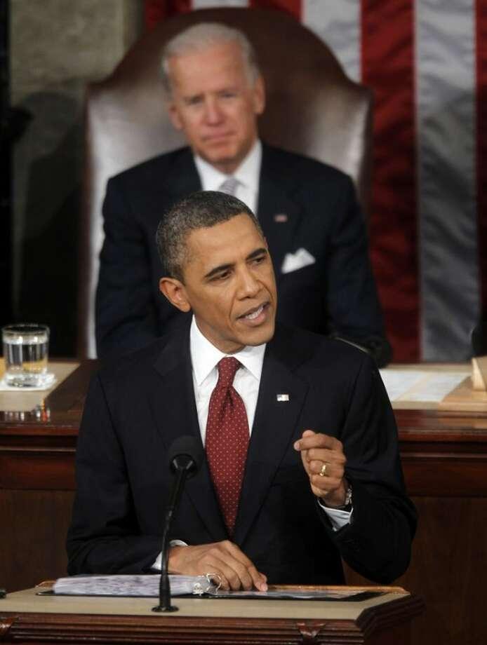 President Barack Obama gives State of the Union address on Capitol in Washington, Tuesday, Jan. 24, 2012. Vice President Joe Biden is behind the president. (AP Photo/Pablo Martinez Monsivais)