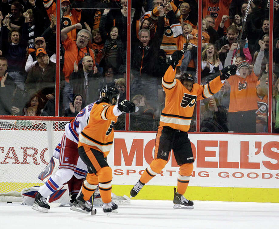 Philadelphia Flyers' Wayne Simmonds, right, and Maxime Talbot celebrate after Simmonds' scored during the first period of an NHL hockey game against the New York Rangers, Saturday, Feb. 11, 2012, in Philadelphia. (AP Photo/Matt Slocum) / AP