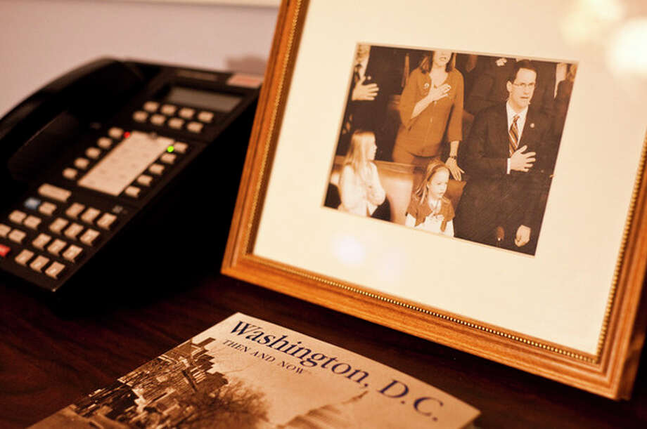 Nov. 19, 2009-A framed photograph taken at Rep. Himes' swearing-in ceremony in Washington, D.C. His two daughters Emma and Linley are next to him. / ©caroline treadway 2009