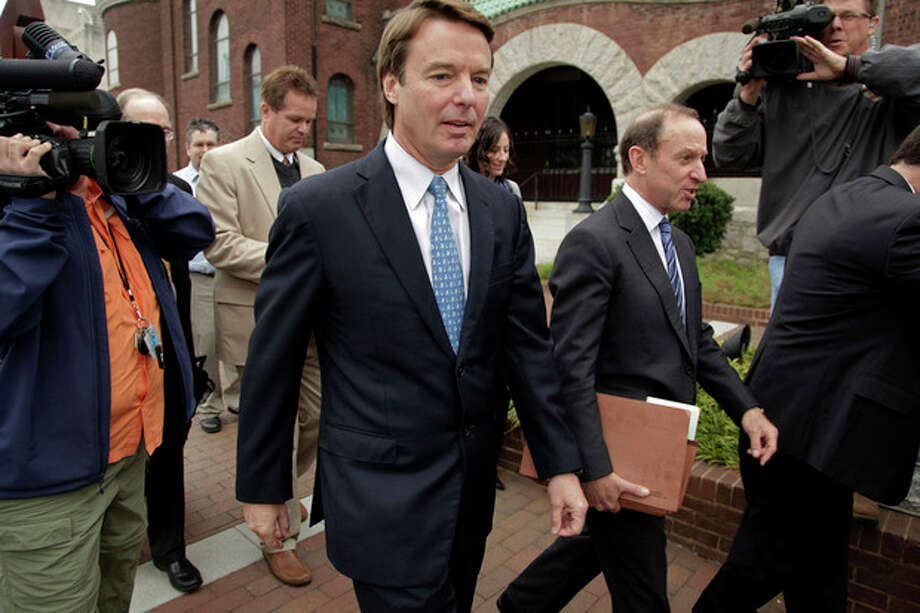 FILE - In this Dec. 16, 2011 file photo, former Senator and presidential candidate John Edwards, center, leaves a federal courthouse with attorney Abbe Lowell, to right of Edwards, after a hearing in Greensboro, N.C. Edwards says he has been diagnosed with a medical condition that will make it difficult for him to attend his criminal trial over campaign finances. In a motion filed Thursday, Dec. 22, 2011, Edwards' defense team asked a judge to delay the start of the trial, scheduled to begin Jan. 30, at least two months. (AP Photo/Chuck Burton, File) / AP2011