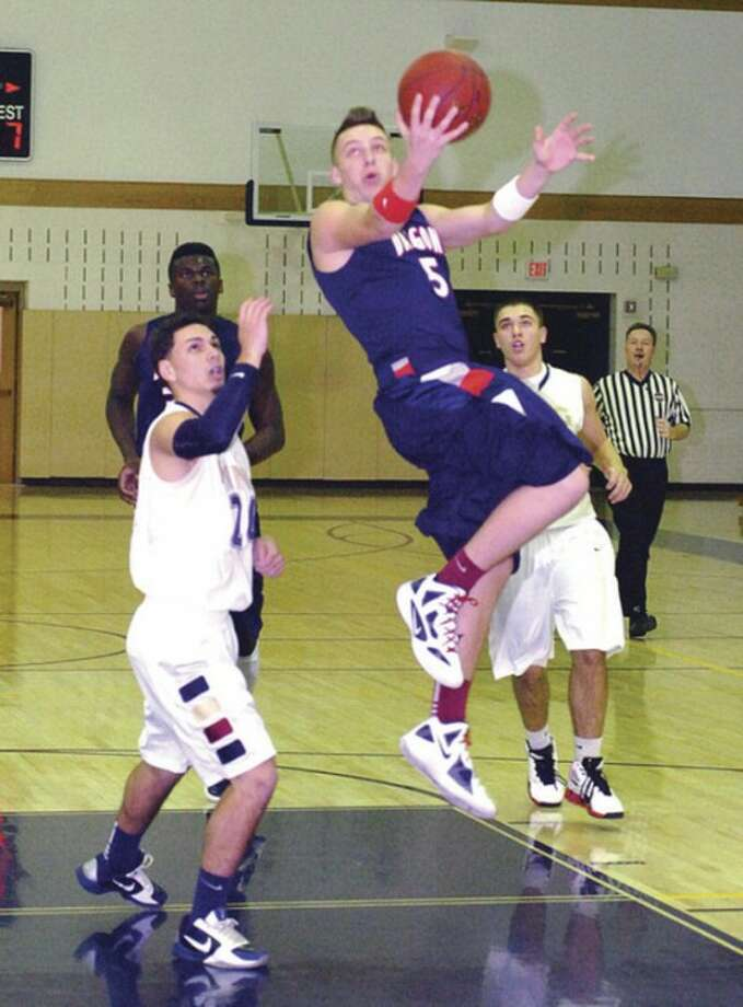 Hour photo/Alex von Kleydorff Hunter Eggers of Greens Farms Academy goes up for a shot during Thursday's game against King in Westport. The Dragons repelled the visiting Vikings in overtime.