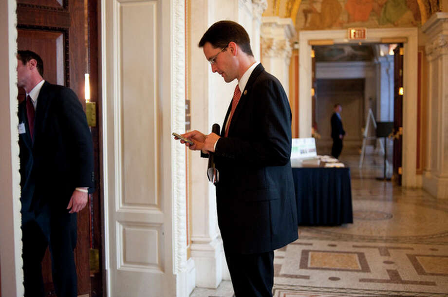 Nov. 19, 2009-Rep. Himes checks his email on a Blackberry before heading into a speech with the 21st Century Democrats Youth Leadership Speaker series in the Library of Congress. / ©caroline treadway 2009