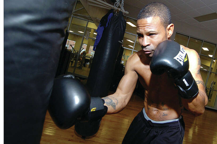 Hour photo/Alex von Kleydorff Shakha Moore of Norwalk works out Wednesday in preparation for his Friday night fight against Mike Arnaoutis at Mohegan Sun Arena. The junior welterweights are scheduled to go six rounds. / © 2012 The Hour Newspapers