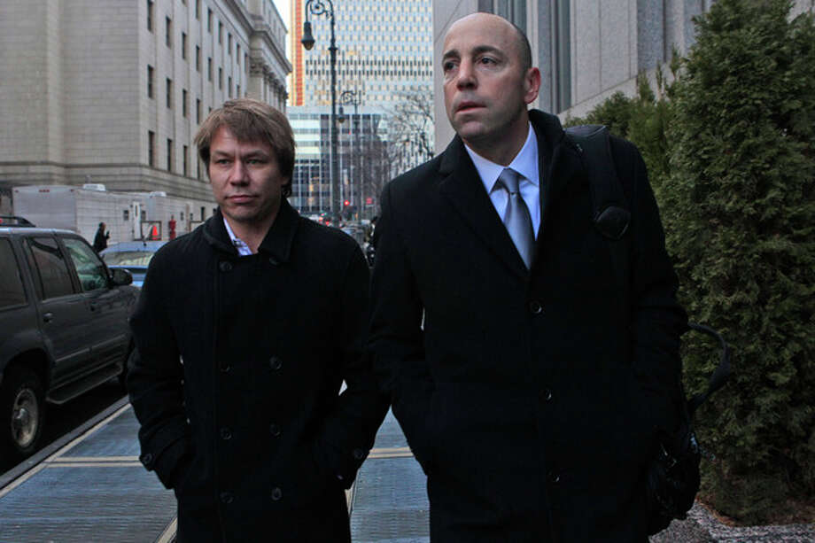Jon Horvath, left, an analyst at Sigma Capital Management leaves Manhattan Federal court in New York with his attorney, Wednesday, Jan. 18, 2012. A hedge fund co-founder, four financial analysts and a Dell Inc. employee teamed up in a record-setting insider trading scheme that netted more than $61.8 million in illegal profits based on trades of a single stock, authorities said Wednesday. They described a cozy network of friends in finance who made the most of their connections with corrupt employees of technology companies. (AP Photo/Mary Altaffer) / AP