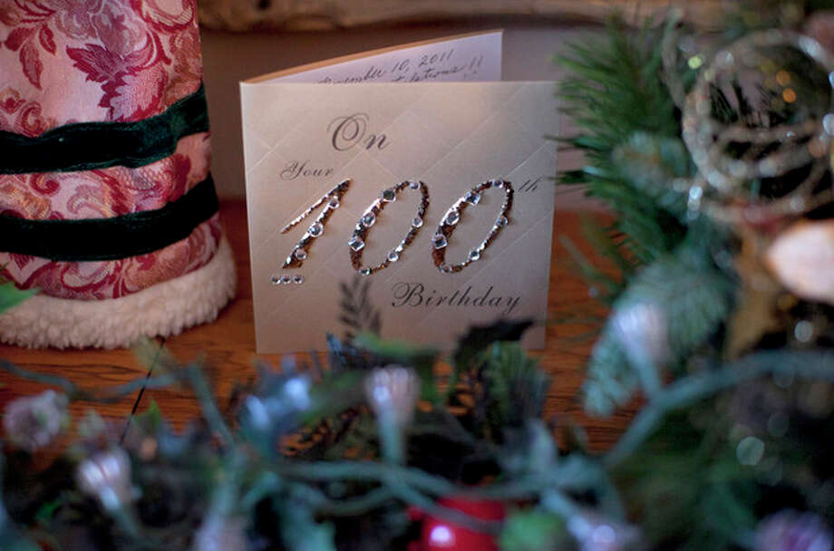 In this Dec. 28, 2011 photo, a birthday card celebrating Minka Disbrow's 100th birthday is seen in her apartment in San Clemente, Calif. Disbrow, who was raped at age 16, has lived to be 100 - long enough to meet the daughter she gave up at birth 77 years earlier and learn about the six grandchildren she didn't know she had. One of them is a space shuttle astronaut. (AP Photo/Jae C. Hong) / AP