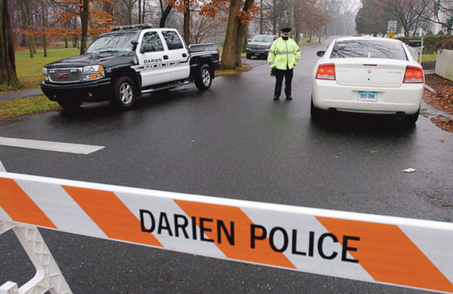 Darien police closed raods around the Occupy Darien event at Tilley Pond Park Wednesday Turn out was low for the first day of the two day event. Hour photo / Erik Trautmann / (C)2011, The Hour Newspapers, all rights reserved