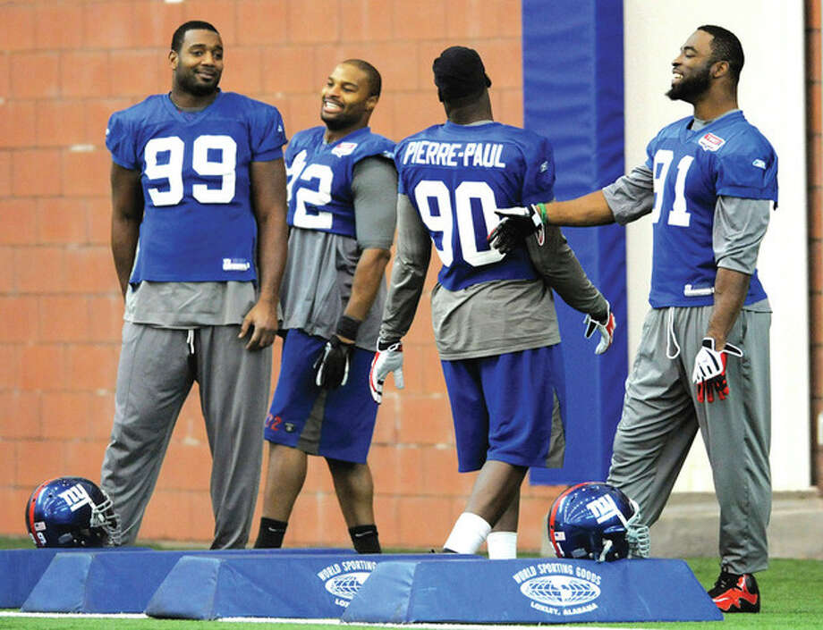 AP photo New York Giants defensive linemen, from left, Chris Canty, Osi Umenyiora, Jason Pierre-Paul and Justin Tuck share a laugh during practice. Come game time, they are a much more fearsome gang. / AP2012