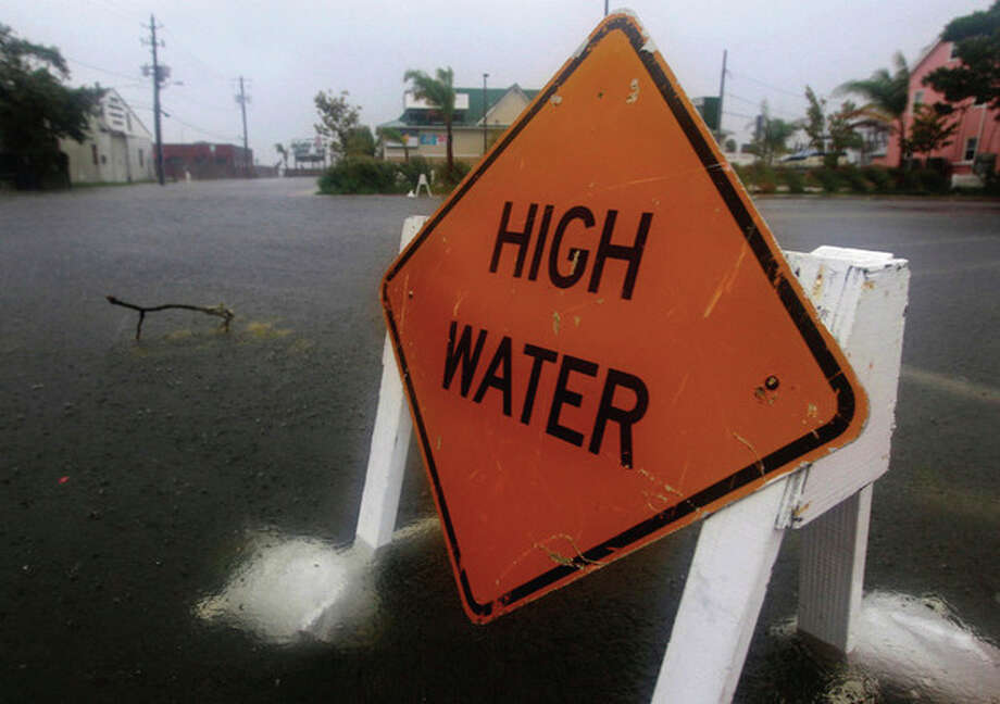 Water rises on a street in Ocean City, Md., Saturday, Aug. 27, 2011, as Hurricane Irene heads toward the Maryland coast. Hurricane Irene knocked out power and piers in North Carolina, clobbered Virginia with wind and churned up the coast Saturday to confront cities more accustomed to snowstorms than tropical storms. (AP Photo/Patrick Semansky) / AP
