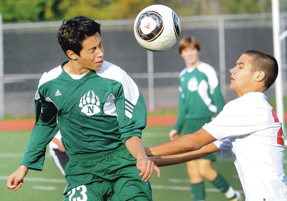 Hour photo/Matthew Vinci Norwalk's Jon Ceja, left, battles fith Mateo Gittings of Greenwich during a play in Wednesday afternoon's game in Greenwich. The two teams battled to a scoreless tie. / (C)2011, The Hour Newspapers, all rights reserved