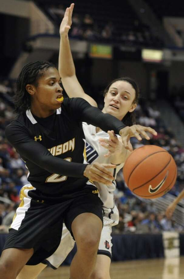 Towson's Deree Fooks, left, passes while Connecticut's Kelly Faris, right defends in the first half of an NCAA college basketball game in Hartford, Conn., Wednesday, Nov. 30, 2011. (AP Photo/Jessica Hill)