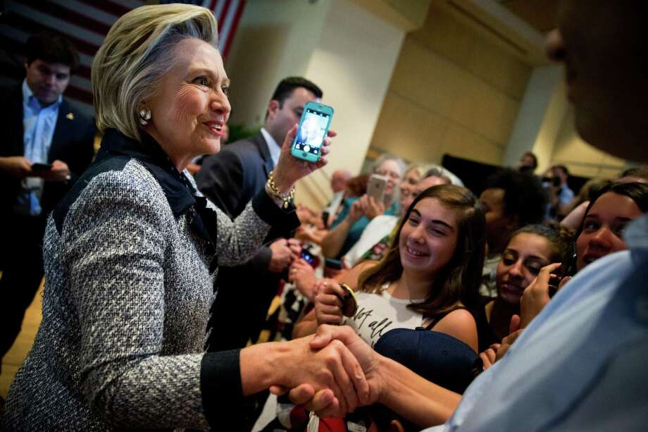 Democratic presidential candidate Hillary Clinton greets members of the audience after speaking at a rally at the International Brotherhood of Electrical Workers Circuit Center in Pittsburgh, Tuesday, June 14, 2016. (AP Photo/Andrew Harnik) Photo: Andrew Harnik, STF / Associated Press / Copyright 2016 The Associated Press. All rights reserved. This material may not be published, broadcast, rewritten or redistribu