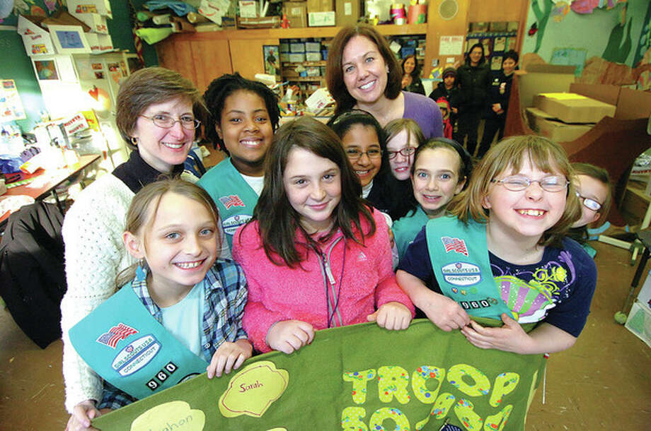 Hour photo / Alex von Kleydorff Girl Scout Troop 960 at Cranbury School prepares to kick off the annual cookie sale fundraiser Wednesday. / © 2012 The Hour Newspapers