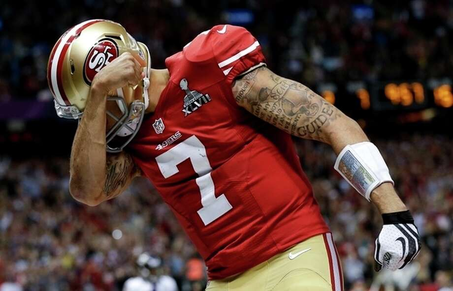 San Francisco 49ers quarterback Colin Kaepernick celebrates his touchdown against the Baltimore Ravens during the second half of the NFL Super Bowl XLVII football game, Sunday, Feb. 3, 2013, in New Orleans. (AP Photo/Dave Martin) / AP