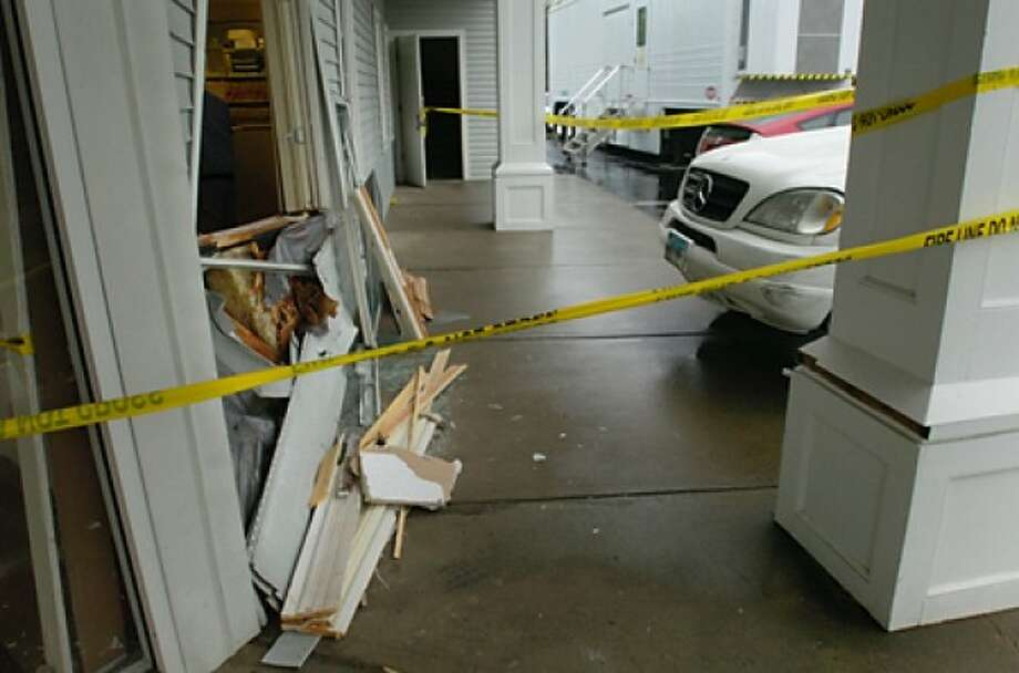 The driver of a Mercedes SUV crashed through the front windows of the Emergency Veterinary Clinic on West Cedar St Wednesday morning. Hour photo / Erik Trautmann