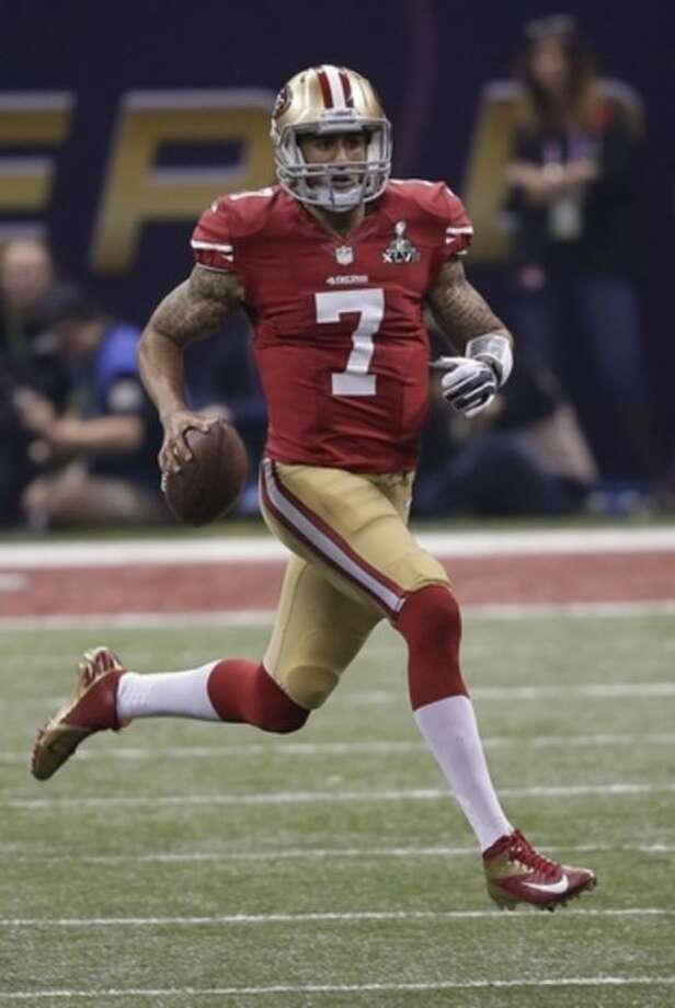 San Francisco 49ers quarterback Colin Kaepernick (7) runs out of the pocket against the Baltimore Ravens during the second half of NFL Super Bowl XLVII football game, Sunday, Feb. 3, 2013, in New Orleans. (AP Photo/Bill Haber)