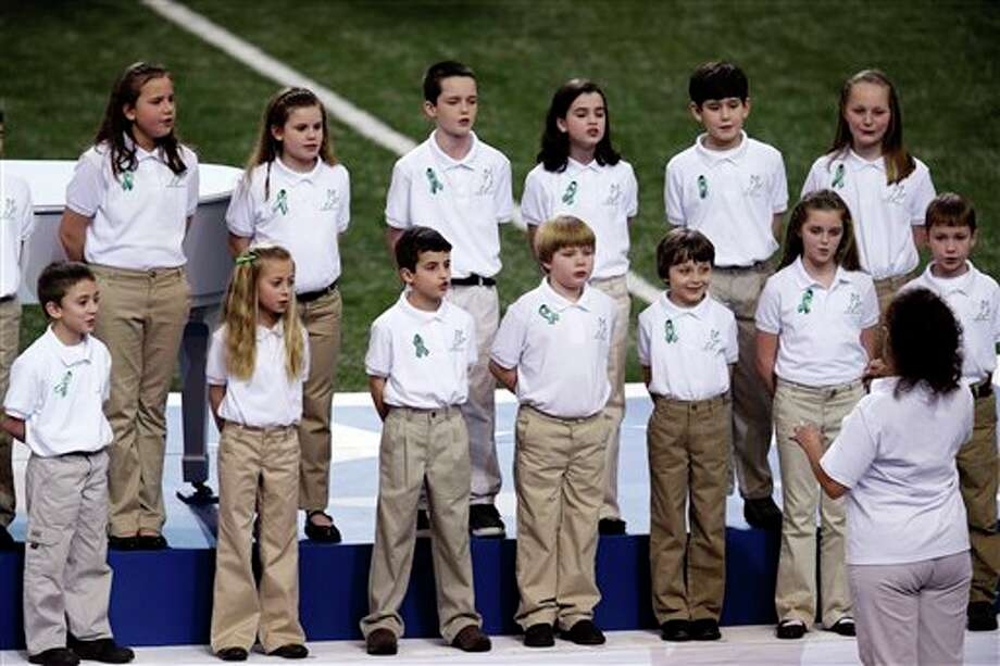 """Students from Sandy Hook Elementary School sing """"America the Beautiful"""" before the NFL Super Bowl XLVII football game between the San Francisco 49ers and the Baltimore Ravens, Sunday, Feb. 3, 2013, in New Orleans. (AP Photo/Charlie Riedel) / AP"""