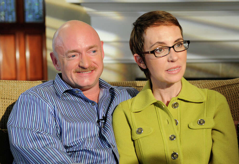 FILE - In this undated photo provided by ABC, U.S. Rep. Gabrielle Giffords and husband Mark Kelly are interviewed by Diane Sawyer on ABC's 20/20. One year after being shot in the head, Rep. Gabrielle Giffords is on a mission to return to the job she so clearly loved. Her husband and people near the three-term congresswoman say she is highly motivated to recover from her injuries and get back to work in Washington, potentially using her inspirational story as a way to mend political differences in the nation's capital. She faces a May deadline to get on the November ballot, meaning she has a few months to decide her next step. (AP Photo/ABC, Ida Mae Astute) / ©2011 American Broadcasting Companies, Inc.  For editiorial use only.  All rights reserved.