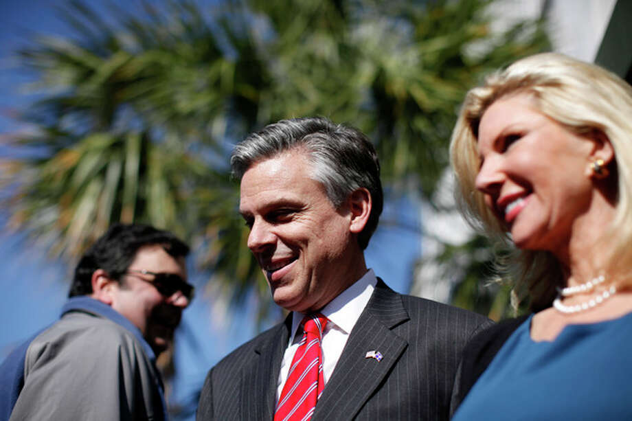Republican presidential candidate, former Utah Gov. Jon Huntsman, accompanied by his wife Mary Kaye, right, after a campaign stop at Virginia's on King restaurant, Sunday, Jan. 15, 2012, in Charleston, S.C. (AP Photo/Matt Rourke) / AP