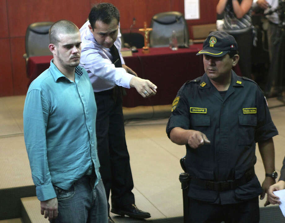 Joran van der Sloot, left, enters the courtroom for the continuation of his murder trial at San Pedro prison in Lima, Peru, Wednesday Jan. 11, 2012. The Dutch citizen sought and received more time to decide how to plead when his trial opened on Jan. 6 for the murder of 21-year-old Stephany Flores on May 30, 2010. (AP Photo/Karel Navarro) / AP