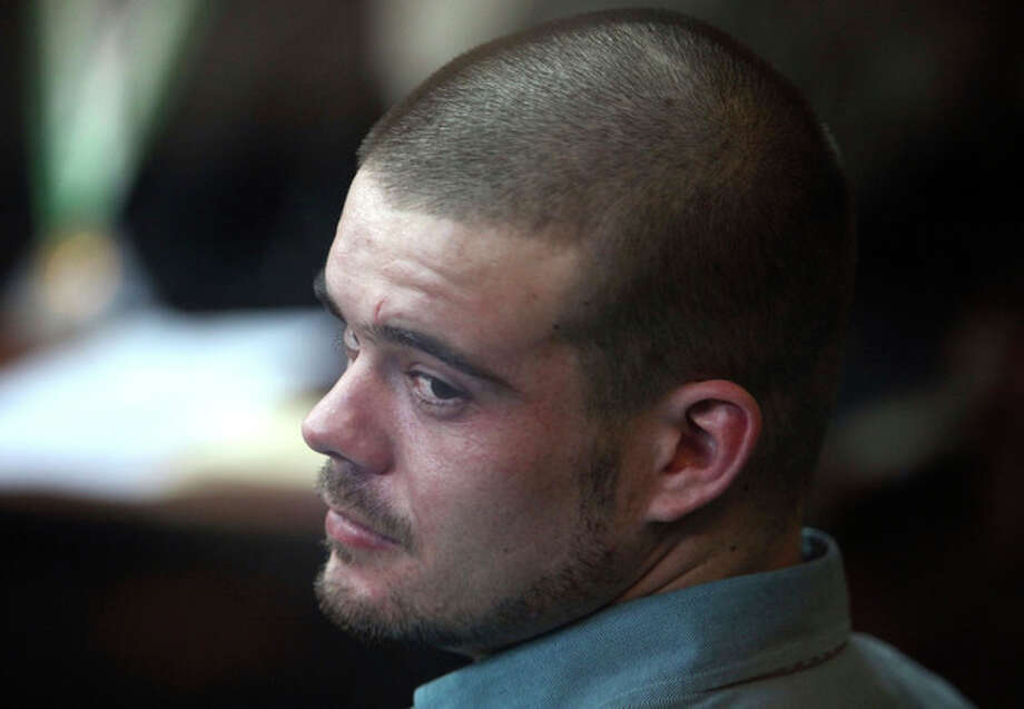 Joran van der Sloot looks back from his seat after entering the courtroom for the continuation of his murder trial at San Pedro prison in Lima, Peru, Wednesday Jan. 11, 2012. Van der Sloot pleaded guilty on Wednesday to the 2010 murder of a 21-year-old Peruvian woman he met at a Lima casino who was killed five years to the day of the unsolved disappearance in Aruba of an American teen in which he remains the main suspect. (AP Photo/Karel Navarro) / AP