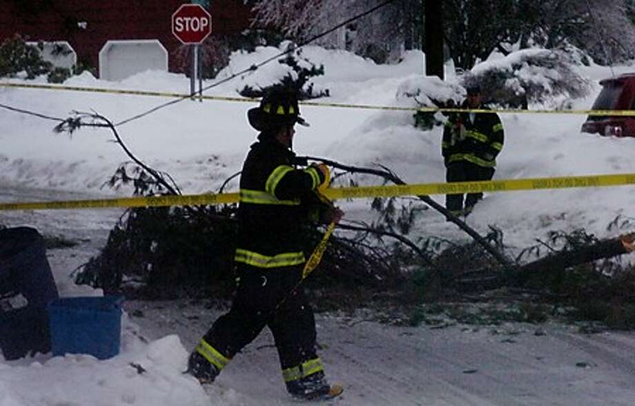 Norwalk firefighters block off Thorn Apple Way Wednesday after an ice storm brought down power. Hour photo / Erik Trautmann