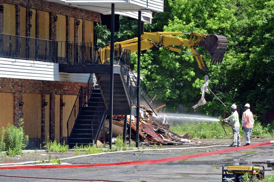 Demolition finally begins at the Skylane Motel on Central Avenue Tuesday June 14, 2016 in Colonie, NY.  (John Carl D'Annibale / Times Union) Photo: John Carl D'Annibale / 40036966A