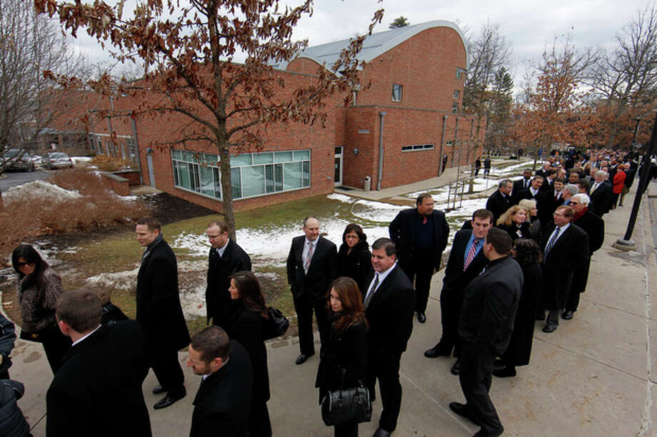 Mourners line up at the Pasquerilla Spiritual Center on the Penn State campus for the viewing for former Penn State football coach Joe Paterno, Tuesday, Jan. 24, 2012, in State College, Pa. (AP Photo/Alex Brandon) / AP