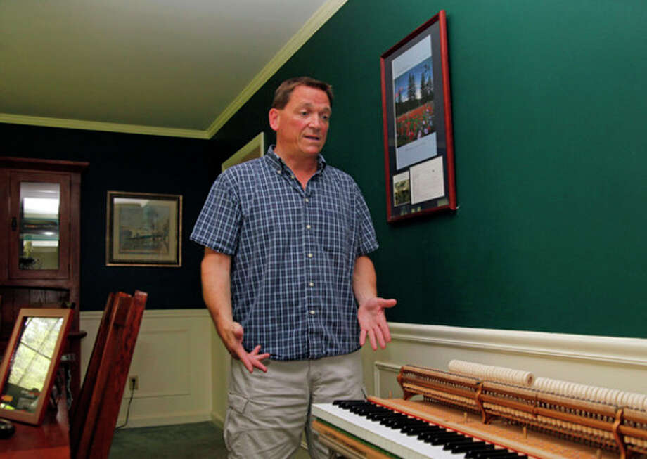 Piano tuner Isaac Halsey speaks about some of the performers whos pianos he has tuned at his home in Norwalk Saturday morning.
