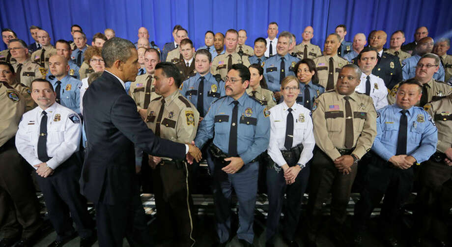 President Barack Obama greets law enforcement officers after speaking on ideas to reduce gun violence, Monday, Feb. 4, 2013, at the Minneapolis Police Department Special Operations in Minneapolis, Minn. (AP Photo/Pablo Martinez Monsivais) / AP