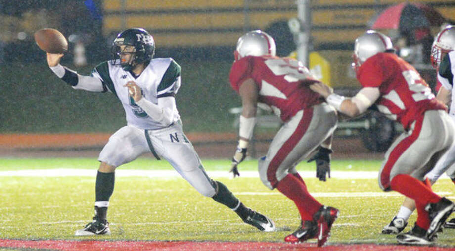 Hour Photo/John Nash Norwalk quarterback Delshawn Wilson pitches the ball to an unseen running back on an option play during Tuesday's win over Conard in the Class LL state football quarterfinals. Wilson likes to talk about 'turning the page,' but with a trip to the semifinals looming on Saturday these Bears are writing a new chapter in NHS football history.