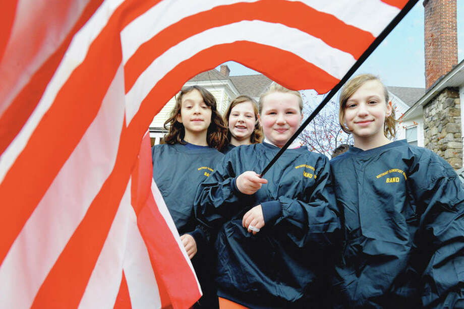 Northeast Elementary School students, Abby Sottile, Alexandra Watkinson, Grace McEvoy and Cassie Lebl at the Veteran's Day parade in Stamford Sunday. hour photo/Matthew Vinci / (C)2011, The Hour Newspapers, all rights reserved