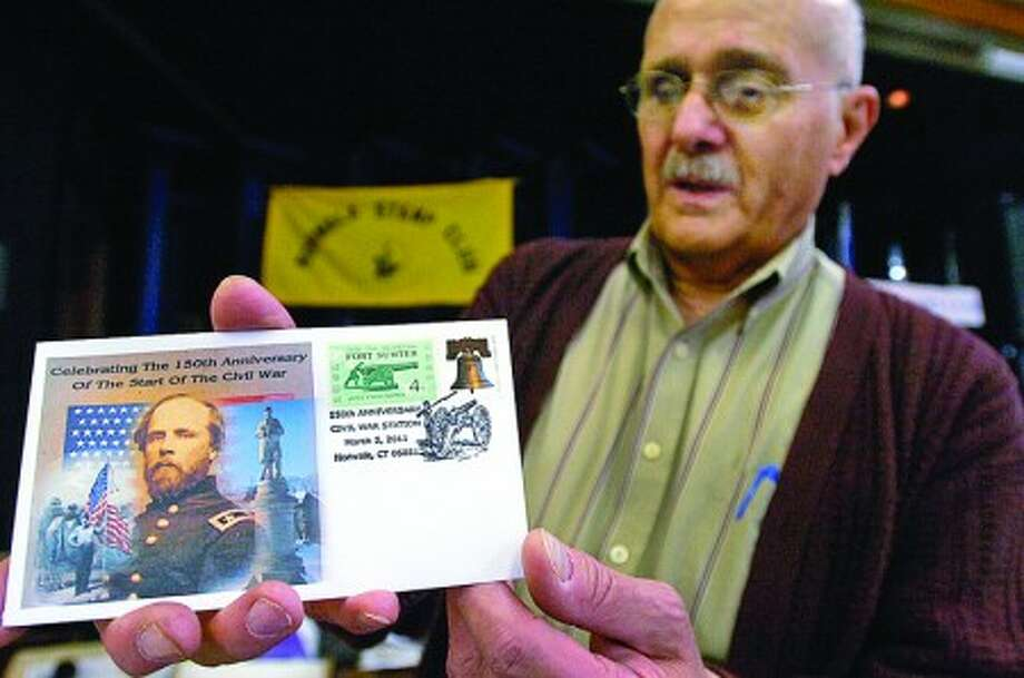 Member of the Norwalk Stamp Club, Fred Gagliardi, display the commerative cachet for sale at the stamp club''s annual show Saturday at the Norwalk Senior Center. Hour photo / Erik Trautmann