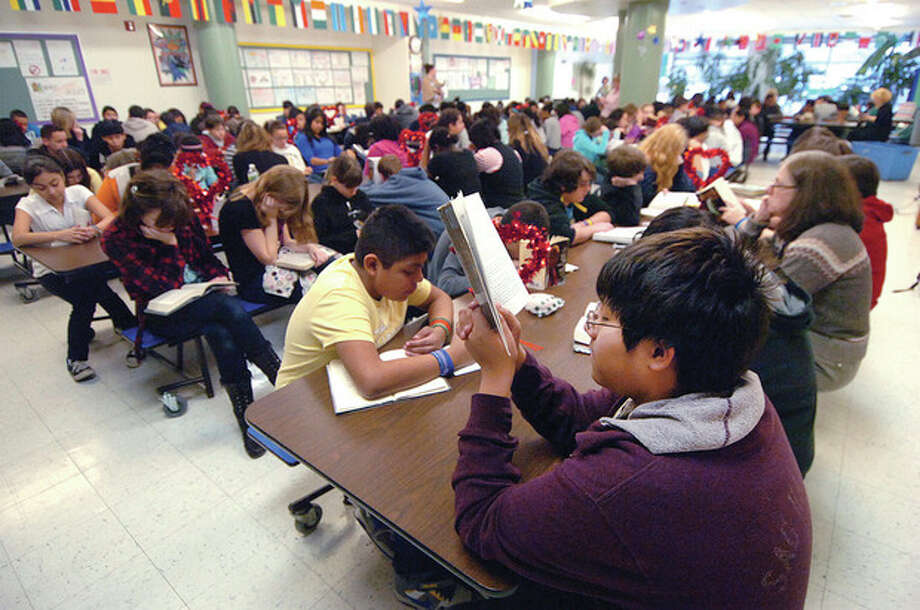 Hour Photo/ Alex von Kleydorff. A full and very quiet cafeteria at West Rocks Middle school during Readathon. / © 2012 The Hour Newspapers