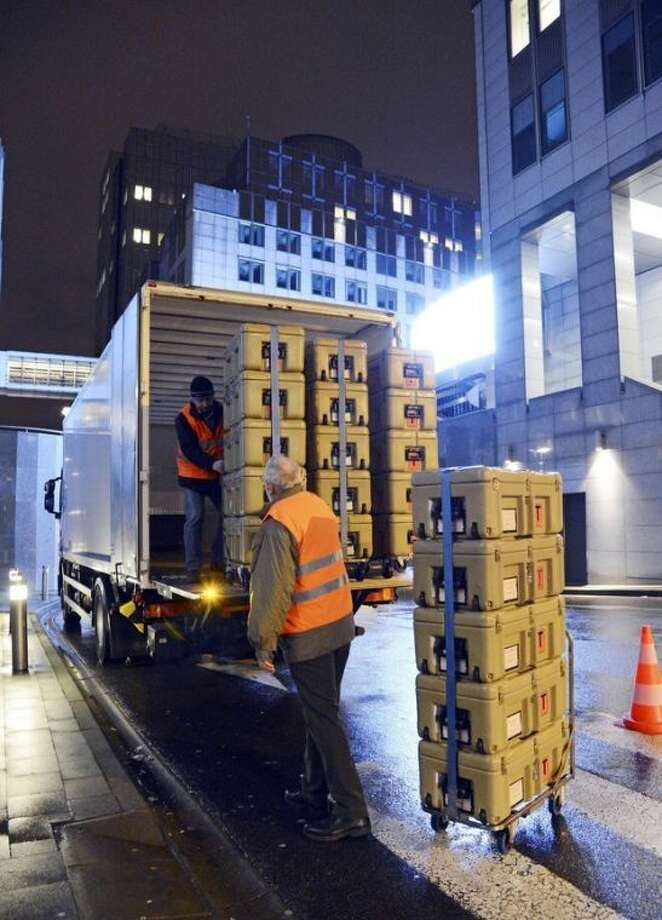 FOR STORY - EUROPE'S TRAVELING PARLIAMENT - Workmen load boxes onto a truck outside the European Parliament building, in Brussels on Friday, Feb. 1, 2013, ready for transportation to Strasbourg in France. The EU set up two parliaments, one at headquarters in Brussels, Belgium, and the other in Strasbourg, France, so in a whirl of trunks, trolleys and backpacks, hundreds of European Union parliamentarians and their staff move some 350-kilometer (220-mile) across the continent for four days of meetings, at an annual cost of about euro 1.3 billion (US dlrs 1.8 billion). (AP Photo/Thierry Charlier)